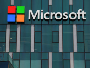 Haifa, Israel - February 1, 2016: Microsoft logo and emblem. Microsoft is an international corporation that develops, supports and sells computer software and services worldwide.
