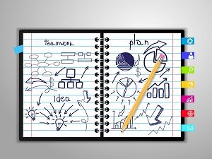 notebook with drawing charts and graphs success business strateg