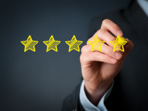 Increase rating evaluation and classification concept. Businessman draw five yellow star to increase rating of his company.